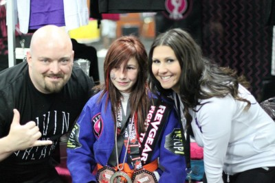 Taylor visiting our booth after winning gold. We have sponsored her since she started competing.